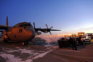 133rd Airlift Wing - In the orange light of the setting sun on 15 Dec. 2009, a 133rd Airlift Wing, Minnesota Air National Guard C-130 H3 model cargo aircraft prepares for a cold weather training flight.