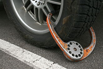 Wheel clamp - A wheel clamp attached to a vehicle at Duke University