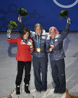 Jennifer Heil - Heil standing on the podium with the other women's moguls medalists