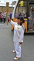 2012 torch relay day 37 Ika Trifiusanti waiting to take up the Olympic flame (7433176608).jpg