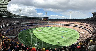 The Melbourne Cricket Ground is strongly associated with the history and development of cricket and Australian rules football, Australia's two most popular spectator sports. 2017 AFL Grand Final panorama during national anthem.jpg