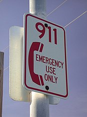"Sign reading ""911 emergency use only"""