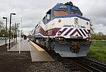 An Altamont Commuter Express train leaving Pleasanton Station