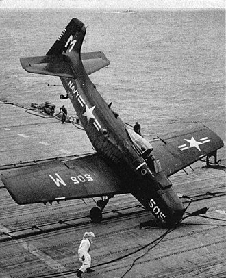 "VFA-25 - A U.S. Navy Douglas AD-4 Skyraider of Attack Squadron 65 (VA-65) ""Fist of the Fleet"" hits the barrier with a faulty tailhook aboard the aircraft carrier USS Yorktown (CVA-10). VA-65 was assigned to Carrier Air Group 2 (CVG-2) aboard the Yorktown for a deployment to the Western Pacific from 3 August 1953 to 3 March 1954."