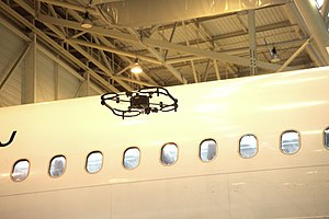 Aircraft maintenance - Autonomous Donecle UAV performing an aircraft inspection.