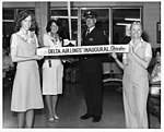 ATL-DEN Inaugural Flight ribbon, with Miss Atlanta (35835362930).jpg