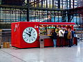 A Quick Snack! Fast Bar Clock in the Principe Pío Station in Madrid Spain.jpg