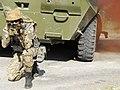 A Ukrainian Soldier near BTR-80.jpg