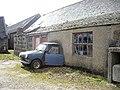 A car and a cheese-press at Wellhouse - geograph.org.uk - 1223673.jpg
