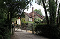A gate and house at Theydon Mount Essex England.JPG