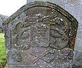 A gravestone with a coat of arms, St Maur's Glencairn Churchyard, Ayrshire.jpg
