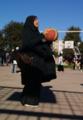 A hijabi girl playing basketball.png