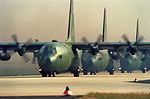 A line of C-130E Hercules aircraft of the 37th Tactical Airlift Squadron taxis prior to departure for Italy DF-ST-90-04407.jpg