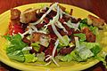 A salad with bacon, cheese and croutons.jpg