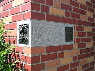 Cornerstone - A cornerstone with bronze relief images
