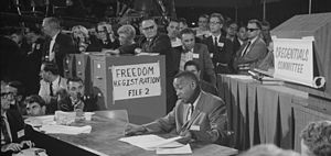 Mississippi Freedom Democratic Party - Aaron Henry reading from a document while seated before the Credentials Committee
