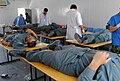 Afghan National Army nurses from the Kandahar Regional Military Hospital collect blood from Afghan National Police recruits at the Regional Training Center-Kandahar.jpg
