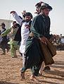 Afghan men dance during intermission at a district wrestling tournament outside of the Zhari district center, Kandahar province, Afghanistan, Dec 111224-A-VB845-358.jpg