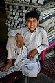 Afghani boy carpet vendor.jpg