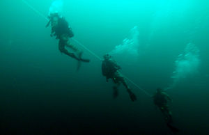 Emergency ascent - Alabama National Guard divers performing a controlled ascent during a training exercise