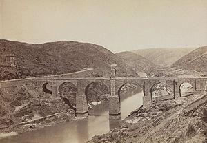 Alcántara Bridge - Photo of the Alcantara bridge (c. 1870), by Jean Laurent, seen from the south