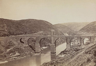 Alcántara Bridge - Photo of the Alcantara bridge (c. 1870), by Jean Laurent, seen from the south