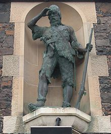 Bronze statue of Selkirk located in a stone alcove
