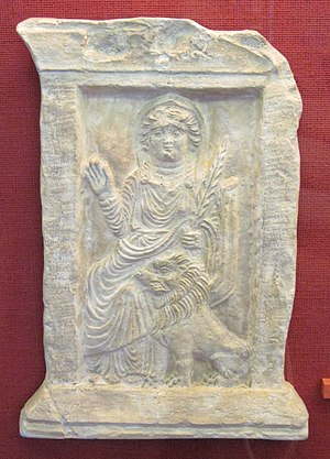 Al-Lat - Allāt with a palm branch and lion from the Ba'alshamîn temple in Palmyra, first century AD. Damascus, Syria