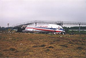 American Airlines Flight 1420 - N215AA's final resting place, having overrun the runway and crashed into the runway landing lights.