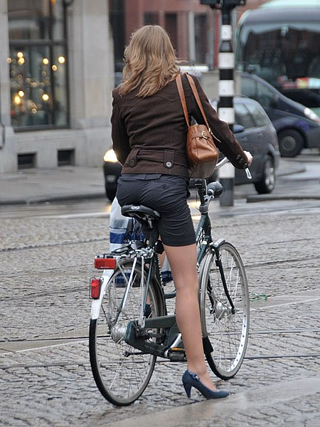 High heels woman on the bike: by