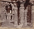 An 1860 photo showing columns of the Quwwat-ul-Islam mosque made from Jain and Hindu temple parts in the Qutub Minar complex at Delhi.jpg