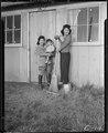 Arcadia, California. At the entrance of their barrack apartment at the Santa Anita Assembly center. . . . - NARA - 537395.tif