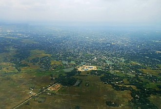 Agartala - Aerial view of agartala, mainly showing the parts of Ramnagar and the Integrated Check Post (ICP)(white landmark) beyond that point is the Indo-Bangla border showing the territory of Bangladesh(paddy field)