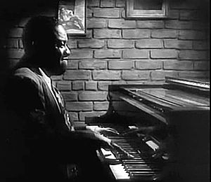 Art Tatum - Screen capture of Tatum from the film The Fabulous Dorseys (1947)