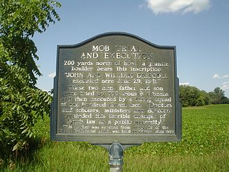 "Banditti of the Prairie - Mob Trial and Execution"", an Illinois historical marker near the mob lynching site where the Banditti ""prairie pirates"", father and son John and William Driscoll of the Driscoll Gang, were tried by an illegal Regulator court of 500 concerned citizens for murder and shot to death by a firing squad of 111 men."
