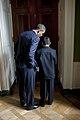 Barack Obama whispers to Javier Garcia of Brownsville, Texas, Oct. 2010.jpg