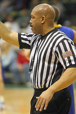 Official (basketball) - NCAA official Moe Kincaid making a call in a 2008 college basketball game