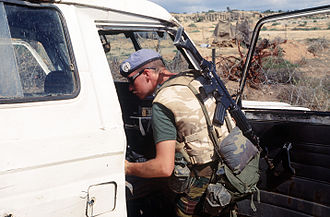 Military beret - A Belgian UN peacekeeper in Somalia, wearing a standard UN blue beret and badge, 1993.