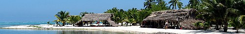 Belize banner Caye with beach huts and palm trees.jpg