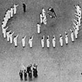 Bellamy salutes detail in 1917, from- Saluting the Flag NGM-v31-p361 (cropped).jpg