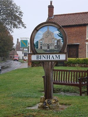 Binham - Binham village sign, depicting the priory