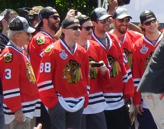 Patrick Kane - Kane (88) during the Blackhawks' 2013 victory rally at Grant Park.