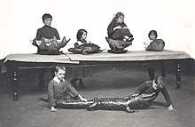 1910s photo of school children being taught to use touch to identify various creatures at Sunderland Museum.