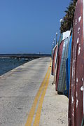 Boats standing at the wall of Jetty Bay in Bugibba.JPG