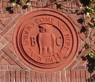 Bohemian Club - The club's mascot owl cast in masonry perched over the main entrance at 624 Taylor. The owl is flanked by the letters B and C and surrounded by words of the club's motto