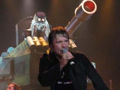 Vocalist Bruce Dickinson during A Matter of Life and Death World Tour. Throughout the tour's first leg, the band played the A Matter of Life and Death album in its entirety. Bruce Dickinson and Eddie 30nov2006.jpg