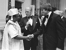 Jenner insieme a Gerald Ford e William Tolbert.