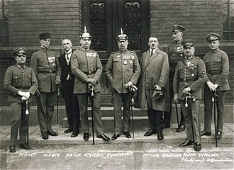 Beer Hall Putsch - Defendants in the Beer Hall Putsch trial. From left to right: Pernet, Weber, Frick, Kiebel, Ludendorff, Hitler, Bruckner, Röhm, and Wagner. Note that only two of the defendants (Hitler and Frick) were wearing civilian clothes