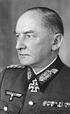 A man wearing a military uniform and neck order in the shape of a cross.