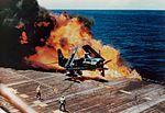 Burning AD-4 Skyraider of VA-55 on USS Essex (CVA-9) c1954.jpg